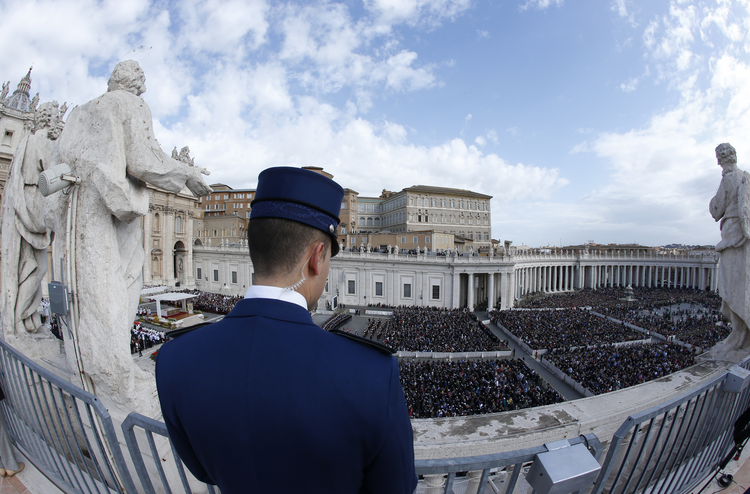 A Vatican police officer at St. Peter's Square during Easter Mass, April 1. (CNS photo/Paul Haring)