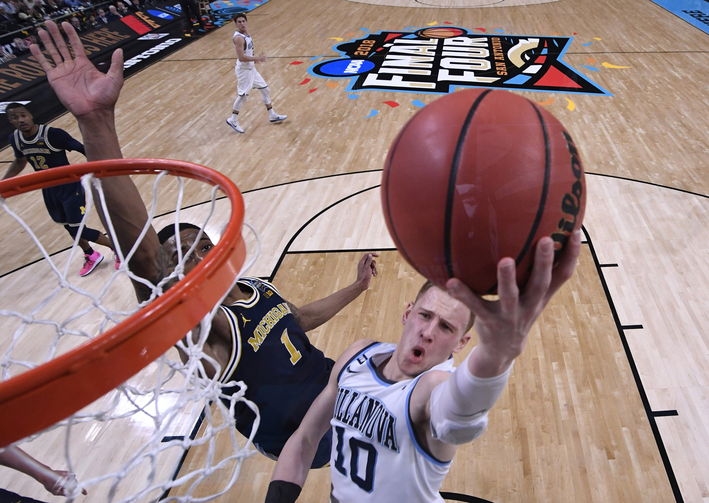 Michigan Wolverines guard Charles Matthews tries to defend a shot from Villanova Wildcats guard Donte DiVincenzo in the N.C.A.A. men's basketball championship on April 2, 2018, in San Antonio. Villanova won its second championship in three years. (CNS photo/ Robert Deutsch, USA TODAY Sports via Reuters)