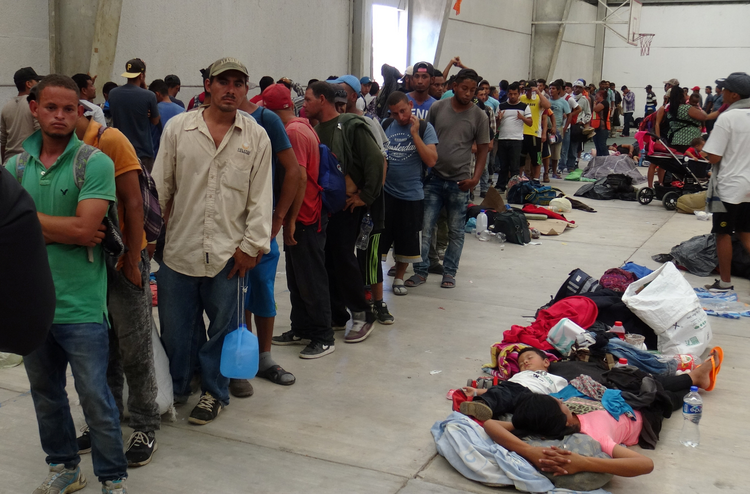 Central American migrants gather before continuing their journey on March 31 in Ixtepec, Oaxaca, Mexico. (CNS photo/Jose Jesus Cortes, Reuters)