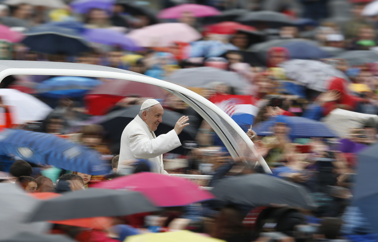 Pope Francis greets the crowd during his general audience in St. Peter's Square at the Vatican April 4. (CNS photo/Paul Haring)