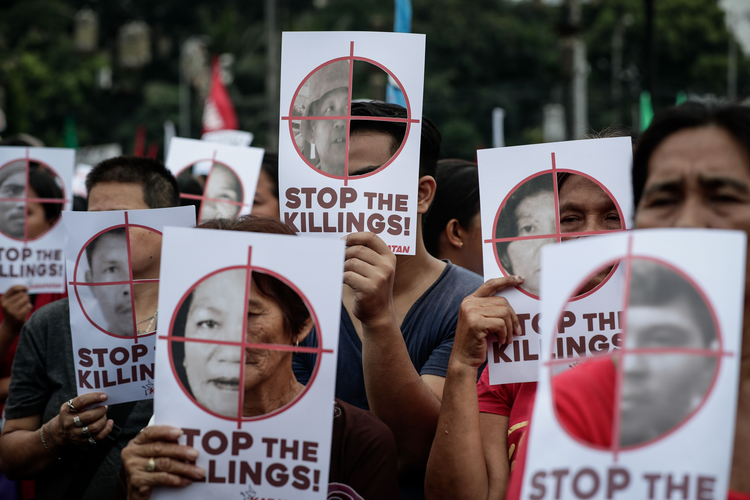 Philippine activists hold banners to mark International Human Rights Day in Manila Dec. 10, 2017. (CNS photo/Mark R. Cristino, EPA)