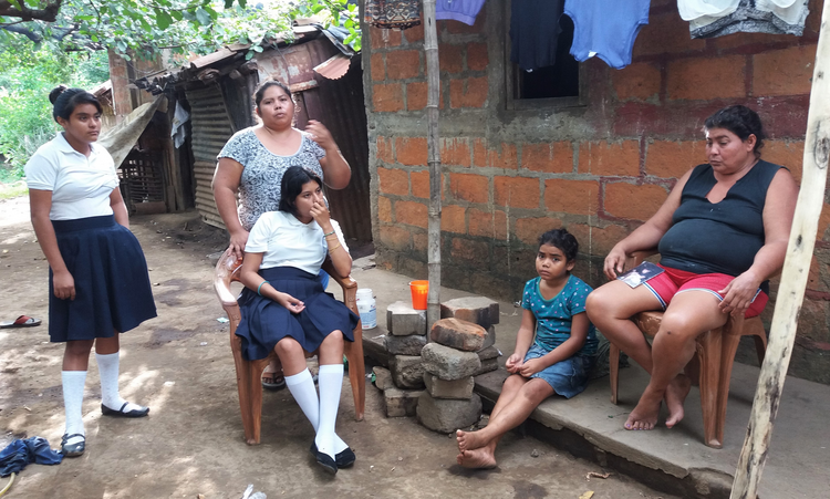 The mother, sister and nieces of Junior Rojas sit outside their home on Aug. 2 in Sutiaba, Nicaragua. On July 5, the Nicaraguan police, with masked and armed paramilitary support, attacked Sutiaba, killing three people, including Rojas. (CNS photo/Steve Lewis)