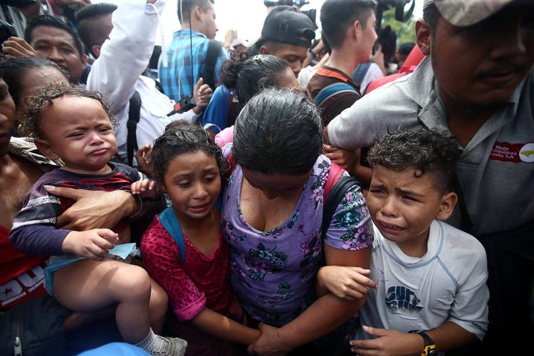 Honduran migrants trying to reach the United States struggle at a border checkpoint on Oct. 19 in Ciudad Hidalgo, Mexico. (CNS photo/Edgard Garrido, Reuters)