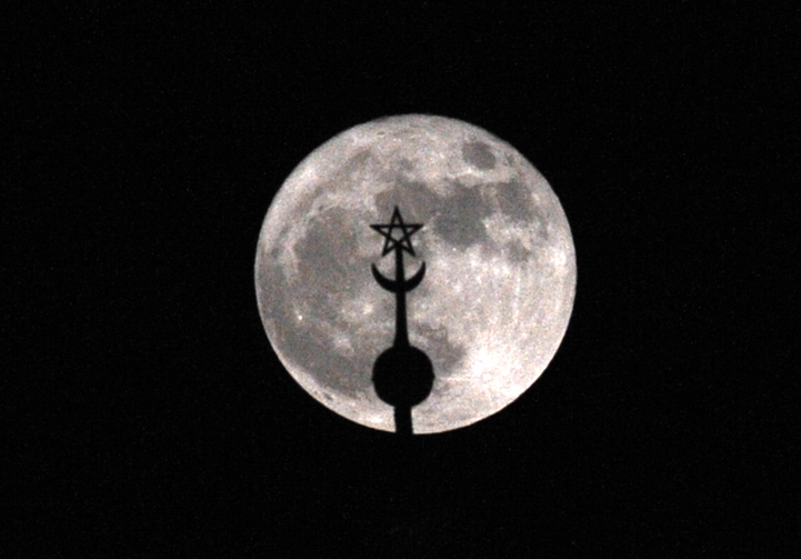 Image: In this 2016 file photo, a super moon rises above the roof of the Mohammed V mausoleum in Rabat, Morocco. Pope Francis is scheduled to visit the North African nation in March 2019. (CNS photo/Abdelhak Senna, EPA)