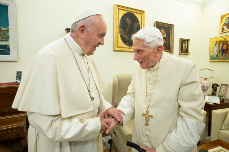 Pope Francis pays a pre-Christmas visit to retired Pope Benedict XVI on Dec. 21, 2018, in the Mater Ecclesiae monastery. (CNS photo/Vatican Media)