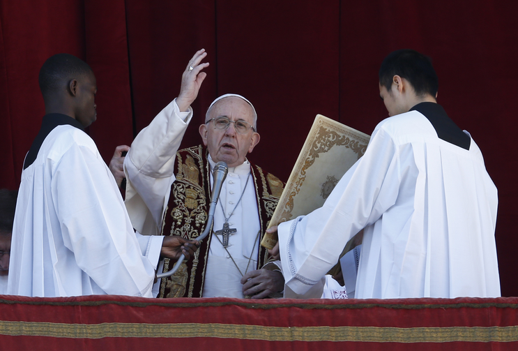"Pope Francis delivers his Christmas blessing ""urbi et orbi"" (to the city and the world) from the central balcony of St. Peter's Basilica at the Vatican Dec. 25. (CNS photo/Paul Haring)"