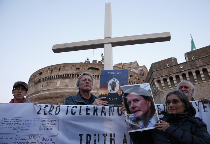 Clerical sex abuse survivors and their supporters rally outside Castel Sant'Angelo in Rome on Feb. 21. (CNS photo/Paul Haring)
