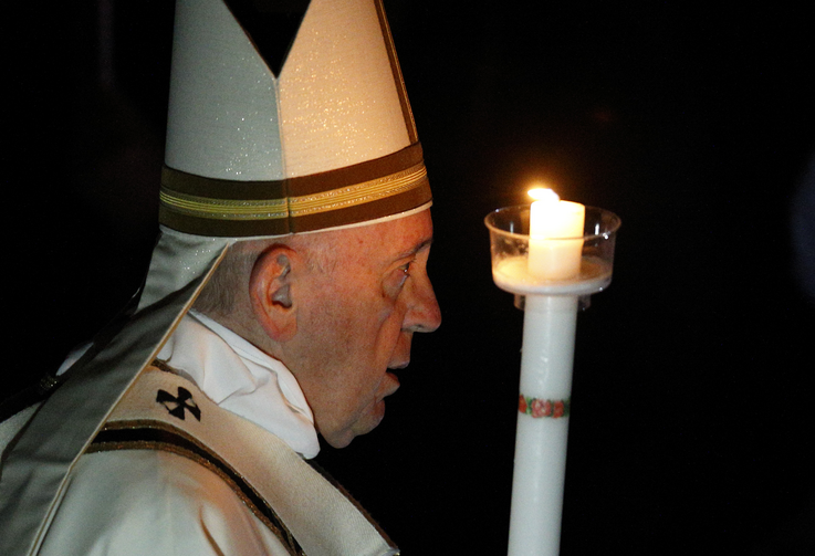 Pope Francis carries a candle in procession as he arrives to celebrate the Easter Vigil in St. Peter's Basilica at the Vatican April 20, 2019. (CNS photo/Paul Haring)