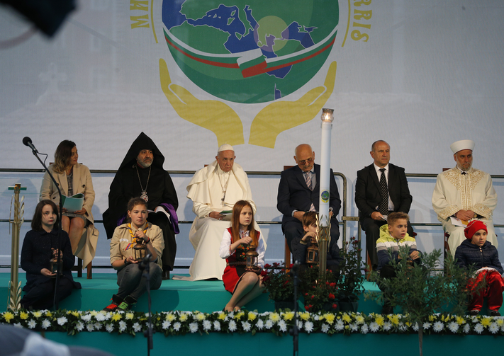 Pope Francis sits near young people as he attends a meeting for peace with Bulgarian representatives of various religious in Nezavisimost Square in Sofia, Bulgaria, May 6, 2019. (CNS photo/Paul Haring)