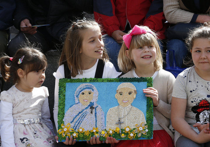 Image: Children hold a gift showing St. Teresa of Kolkata and Pope Francis before the pope's visit to the Mother Teresa Memorial in Skopje, North Macedonia, May 7, 2019. (CNS photo/Paul Haring)