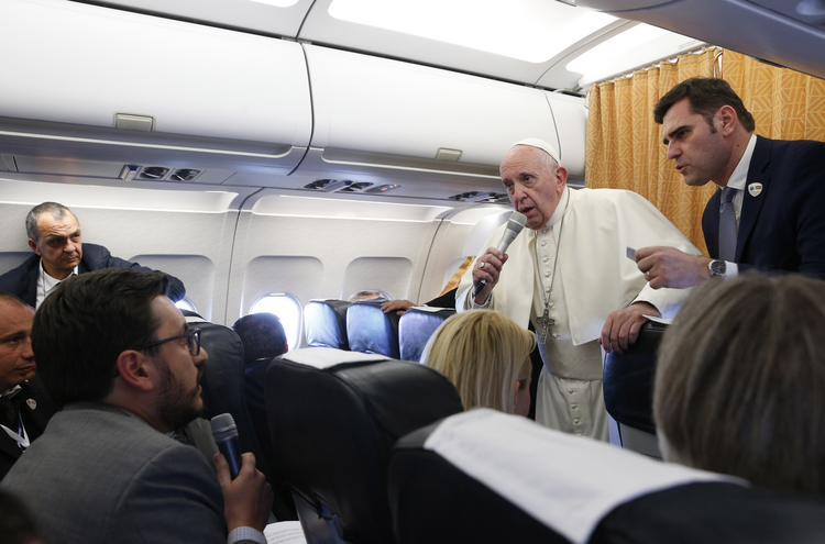 Pope Francis with reporters aboard his flight from Skopje, North Macedonia, to Rome on May 7, 2019. (CNS photo/Paul Haring)