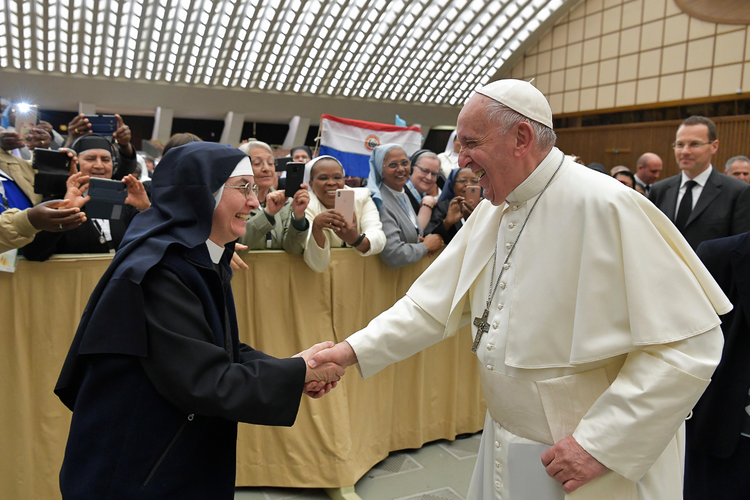 Pope Francis greets a nun during a meeting with 850 superiors general on May 10, 2019, at the Vatican, who were in Rome for the plenary assembly of the International Union of Superiors General. (CNS photo/Vatican Media via Reuters)