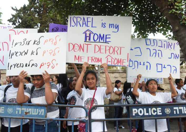 Image: Filipino children demonstrate June 12, 2019, near Israeli Prime Minister Benjamin Netanyahu's house in Jerusalem. Their signs, in English and Hebrew, say they do not want to be deported. Most of their mothers arrived legally in Israel to work as caretakers for the elderly, but then remained in the country after their work visas had expired and have lived in Israel for up to 20 or more years. (CNS photo/Debbie Hill)