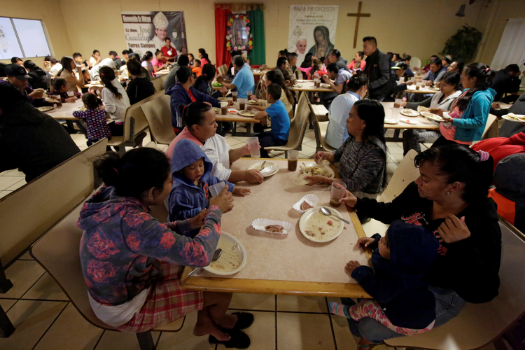 Migrants eat at a Catholic-run shelter in Ciudad Juarez, Mexico, May 10, 2019. (CNS photo/Jose Luis Gonzalez, Reuters)