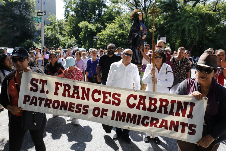 A procession for immigrant rights on July 13 in the streets surrounding St. Frances Xavier Cabrini Shrine in New York City. (CNS photo/Gregory A. Shemitz)