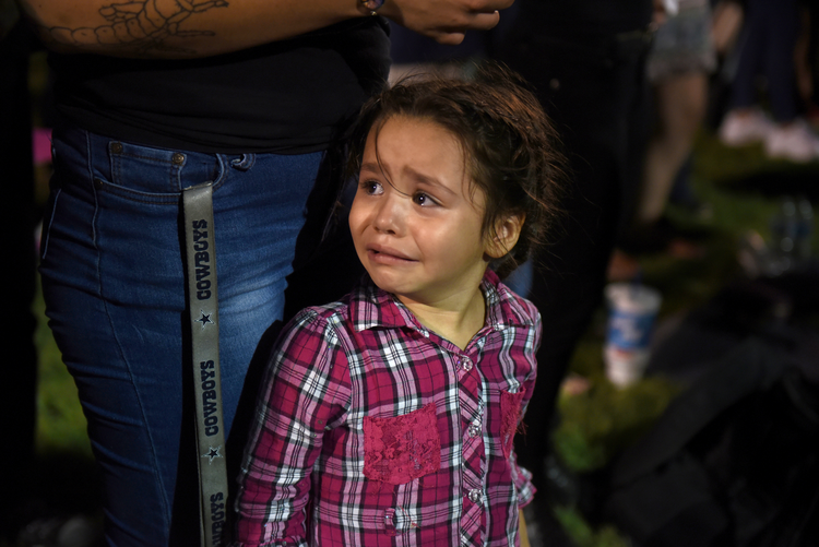 Serenity Lara cries during an Aug, 4, 2019, vigil, a day after a mass shooting at a Walmart store in El Paso, Texas. Pope Francis joined Catholic Church leaders expressing sorrow after back-to-back mass shootings in the United States left at least 31 dead and dozens injured in Texas and Ohio Aug. 3 and 4. (CNS photo/Callaghan O'Hare, Reuters)