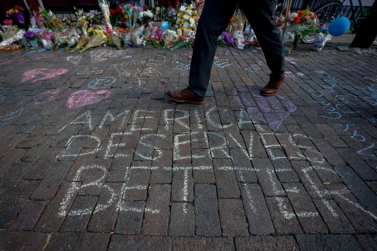 "A man walks past a memorial on Aug. 7, 2019, for those killed in a mass shooting in Dayton, Ohio, four days earlier. Three U.S. bishops' committee chairmen issued a statement Aug. 8 to call on the nation's elected officials ""to exert leadership in seeking to heal the wounds"" of the country caused by the Aug. 3 and 4 mass shootings and urged an end to hateful rhetoric many see as a factor in the violence particularly in Texas. The Aug. 3 shooting in El Paso, Texas, was followed less than 24 hours later by th"