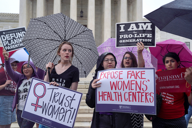 A woman who supports abortion access stands alongside pro-life supporters during a rally outside the U.S. Supreme Court in Washington in June 2018. (CNS photo/Toya Sarno Jordan, Reuters)