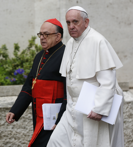 Pope Francis and Cardinal Raymundo Damasceno Assis of Aparecida, Brazil, walk to a meeting of cardinals in the synod hall at the Vatican Feb. 20, 2014. In a statement released by the Vatican Sept. 28, 2019, the pope named Cardinal Damasceno as pontifical commissioner of the Heralds of the Gospel and its religious branches for consecrated men and women. (CNS photo/Paul Haring)