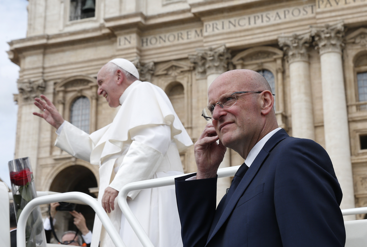Domenico Giani, lead bodyguard for Pope Francis and head of the Vatican police force, keeps watch as the pope leaves his general audience in St. Peter's Square at the Vatican May 1, 2019. Pope Francis accepted the resignation of Giani Oct. 14, nearly two weeks after an internal security notice was leaked to the Italian press. (CNS photo/Paul Haring)
