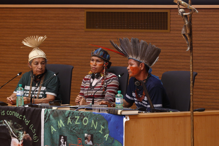 Francisco Chagas Chafre de Souza, a leader of the Apurina in Brazil's Amazon region, speaks at a meeting of indigenous people from North America and South America at the Jesuit General Curia in Rome Oct. 17, 2019. Also pictured are Dona Zenilda with the Xucuru people of northeast Brazil, and Ednamar de Oliveira Viana, a leader of the Satere-Mawe people in Brazil. The meeting was a side event to the Synod of Bishops for the Amazon. (CNS photo/Paul Haring)