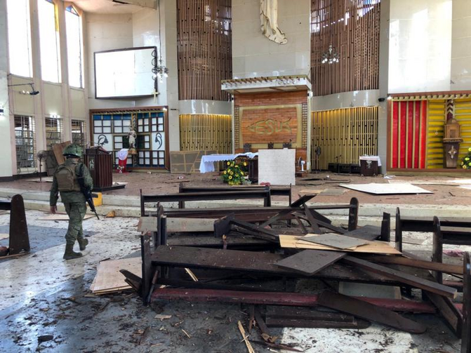 Image: A Philippine army member inspects damage inside the Cathedral of Our Lady of Mount Carmel following a bomb blast in Jolo Jan. 27, 2019. (CNS photo/Armed Forces of the Philippines via Reuters)