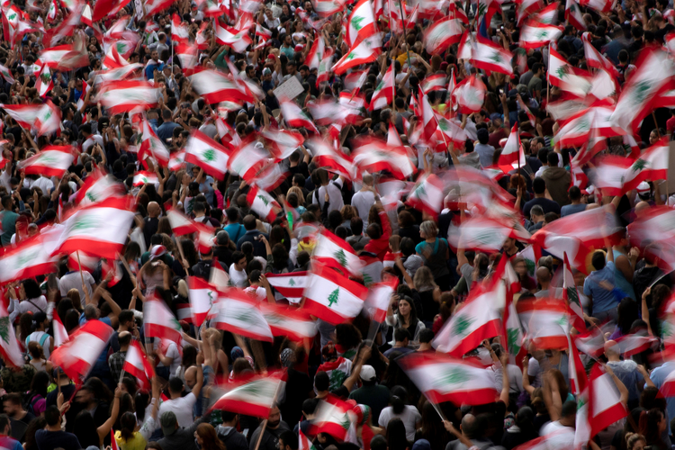 Image: Demonstrators wave Lebanese flags during an anti-government protest on a highway in Jal el-Dib Oct. 23, 2019. The Oct. 29 resignation of Lebanese Prime Minister Saad Hariri followed 13 days of massive country-wide demonstrations. (CNS photo/Alkis Konstantinidis, Reuters)