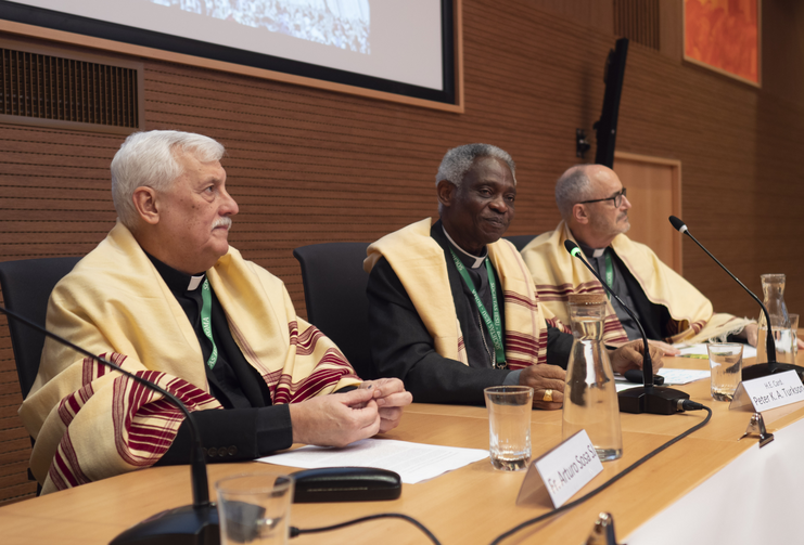 Father Arturo Sosa, superior general of the Jesuits, Cardinal Peter Turkson, prefect of the Dicastery for Promoting Integral Human Development, and Cardinal Michael Czerny, undersecretary of the Migrants and Refugee Section of the Vatican Dicastery for Promoting Integral Human Development, attend a meeting in Rome Nov. 4, 2019. The meeting marked 50 years of the Jesuits' Social Justice and Ecology Secretariat. (CNS photo/courtesy Jesuits)