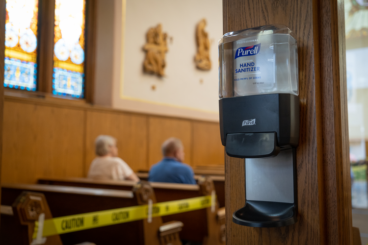 The Paycheck Protection Program has helped parishes to keep church doors open during the pandemic, a time of increasing need for spiritual support. (CNS photo/Katie Rutter)