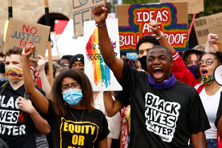 Demonstrators in Denver advocate for Black, indigenous and Latino communities July 4, 2020. (CNS photo/Kevin Mohatt, Reuters)