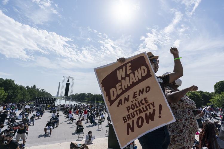 "People gather at the Lincoln Memorial in Washington on Aug. 28, the 57th anniversary of the Rev. Martin Luther King Jr.'s ""I Have A Dream"" speech and the March on Washington. (AP Photo/Alex Brandon)"
