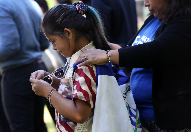 Marilyn Miranda, 9, draped in a Salvadoran flag, attends an immigration rally with her mother outside the U.S. Capitol in Washington June 4, 2019. A Sept. 14, 2020, decision from the U.S. Court of Appeals for 9th Circuit in Ramos v. Nielsen brings the Trump administration one step closer to ending Temporary Protected Status, or TPS, for almost all people with TPS in the United States. (CNS photo/Leah Millis, Reuters)