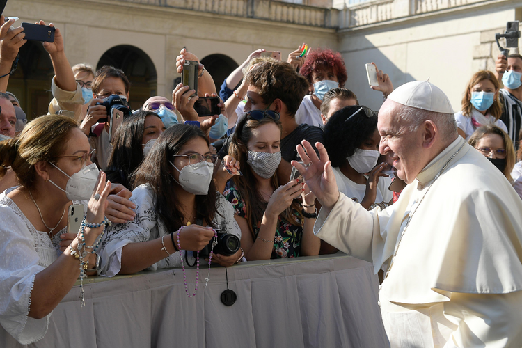Pope Francis greets the crowd as he arrives for his general audience in the San Damaso courtyard at the Vatican Sept. 16, 2020. (CNS photo/Vatican Media)