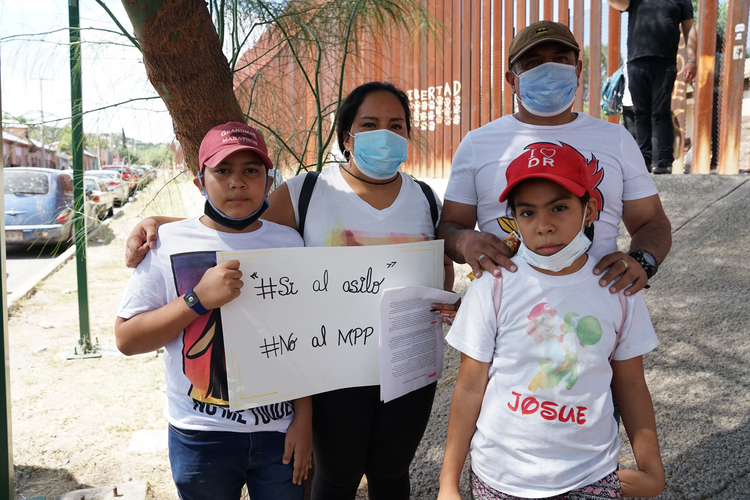 Xiomara Martinez, pictured here with her two children, both U.S. citizens, and her brother, Sergio, traveled to Nogales, Sonora. They have been waiting to petition for asylum for six months. (J.D. Long-García)
