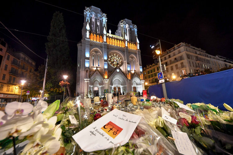 "Tributes to the dead are seen outside of Notre Dame Basilica in Nice, France, Nov. 1, 2020, as French bishops conduct a ""penitential rite of reparation,"" following the Oct. 29 deadly attack at church. (CNS photo/Lionel Urman, Panoramic via Reuters)"