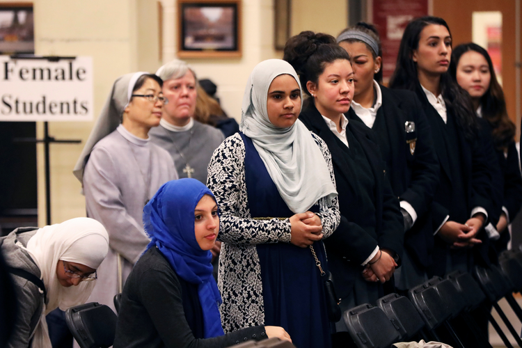 Students from MDQ Academy Islamic School in Brentwood, N.Y., and St. Anthony's High School in nearby Huntington, N.Y., listen to speakers at an interfaith event at the Catholic school on April 26, 2017. (CNS photo/Shannon Stapleton, Reuters)