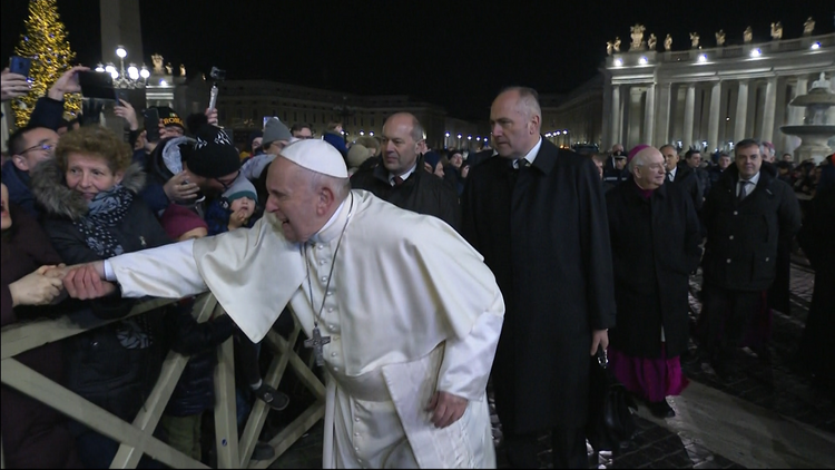 "A woman pulls Pope Francis' hand as he greets people while walking to visit the Nativity scene in St. Peter's Square at the Vatican Dec. 31, 2019. At his Jan. 1 Angelus the pope apologized for the ""bad example"" he gave when he slapped this woman's hand. (CNS photo/Vatican Media)"
