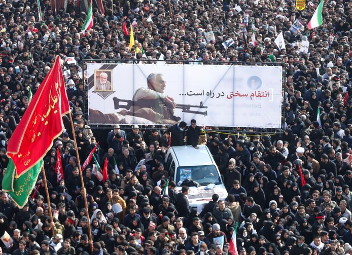 Image: Mourners attend a funeral procession for Iranian Maj. Gen. Qasem Soleimani and Iraqi militia commander Abu Mahdi al-Muhandis in Tehran, Iran, Jan. 6, 2020. The two men were killed Jan. 3 in a U.S. drone airstrike at Baghdad International Airport. (CNS photo/Nazanin Tabatabaee/, West Asia News Agency via Reuters)
