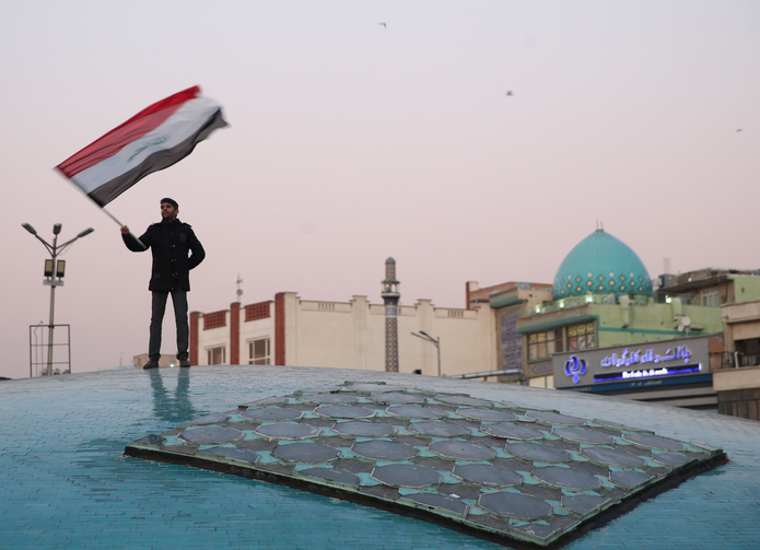 A man celebrates in Tehran, Iran, on Jan. 8, 2020, after the country launched missiles at U.S.-led forces in Iraq. (CNS photo/Nazanin Tabatabaee, West Asia News Agency via Reuters)