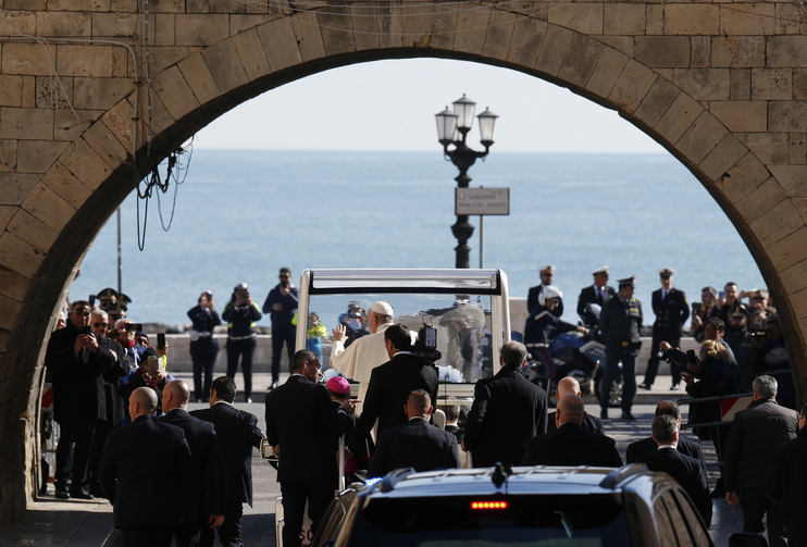 "Image: Pope Francis leaves through an arch of the old city after attending the meeting, ""Mediterranean, Frontier of Peace,"" at the Basilica of St. Nicholas in Bari, Italy, on Feb. 23, 2020. (CNS photo/Paul Haring)"