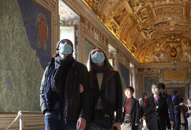 People wearing masks for protection from the coronavirus tour the Vatican Museums at the Vatican Feb. 29. (CNS photo/Paul Haring)