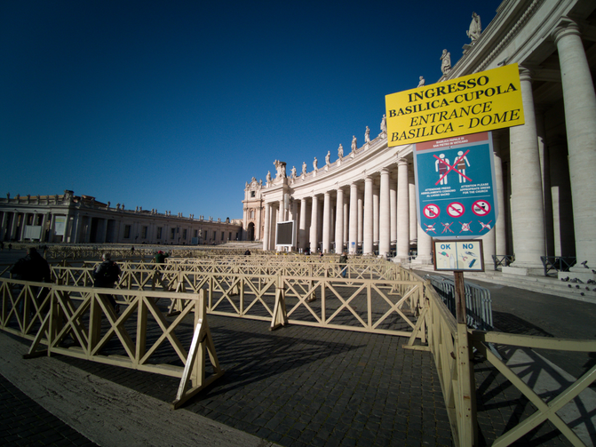 Several visitors enter an empty security queue before visiting St. Peter's Basilica at the Vatican on March 4. Visitors and pilgrims to churches, museums and landmarks in Rome have sharply declined following an outbreak of the COVID-19 coronavirus in northern Italy. (CNS photo/Junno Arocho Esteves)