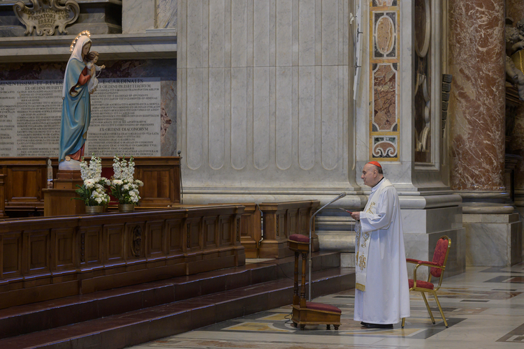 Cardinal Angelo Comastri, archpriest of St. Peter's Basilica, leads a Marian prayer service in the basilica at the Vatican on March 11. In attendance were some Vatican employees seated one meter apart as a precaution against the coronavirus. (CNS photo/Vatican Media)