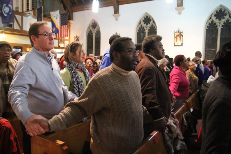 People join hands during a service at St. Katharine Drexel Church in Chester, Pa. In a March 12, 2020, announcement, the Philadelphia Archdiocese said Catholics in the archdiocese who do not wish to attend Sunday Mass for fear of spreading or contracting coronavirus are no longer obligated to do so, until further notice. (CNS photo/Sarah Webb, CatholicPhilly.com)