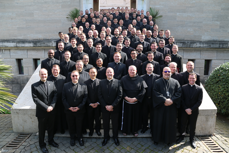 The staff and 92 seminarians at the Pontifical North American College in Rome pose for a photograph March 15, 2020, on the steps leading to the seminary chapel. A week later, the college informed the seminarians that they should return to the United States because of the ongoing COVID-19 pandemic. (CNS photo/courtesy of the Pontifical North American College)