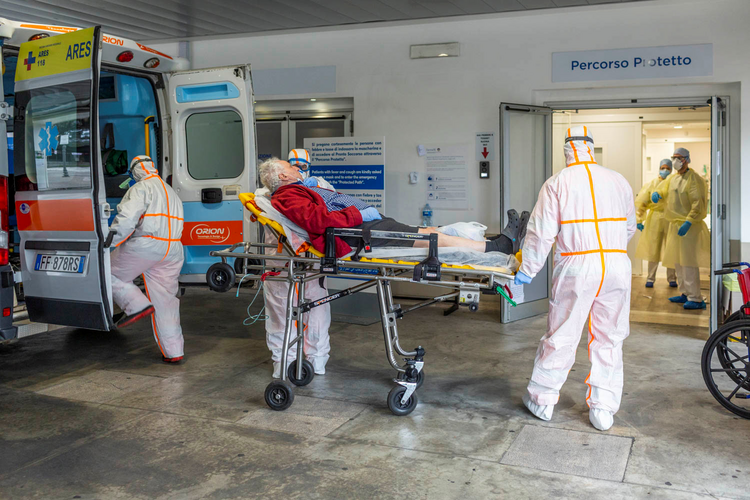 Medical workers at Gemelli Hospital in Rome wear protective suits as they attend an elderly coronavirus patient on March 16, 2020. (CNS photo/Policlinico Gemelli, handout via Reuters)