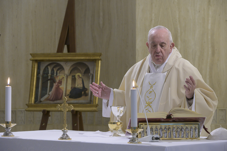 Pope Francis celebrates Mass on the feast of the Annunciation, March 25, 2020, in the chapel of the Domus Sanctae Marthae at the Vatican. (CNS photo/Vatican Media)