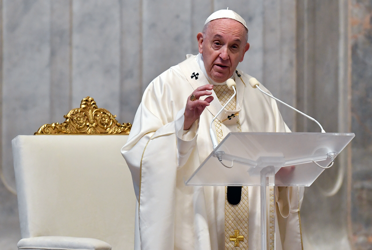 Pope Francis delivers the homily as he celebrates the Mass of Lord's Supper April 9, 2020, in St. Peter's Basilica at the Vatican. (CNS photo/Vatican Media via Reuters)