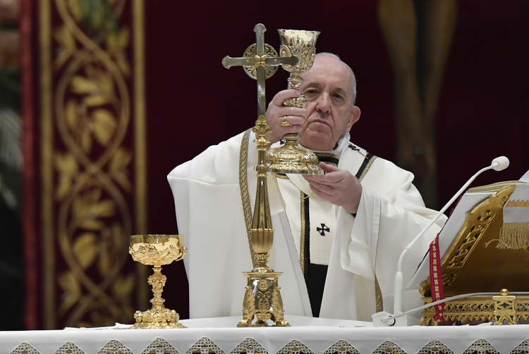 Pope Francis celebrates the Eucharist during Easter Mass in St. Peter's Basilica at the Vatican on April 12. The Mass was celebrated without the presence of the public due to the coronavirus pandemic. (CNS photo/Vatican Media)