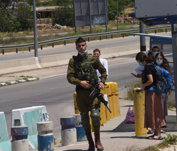 An Israeli soldier guards at the Gush Etzon Settlements junction near Bethlehem, West Bank, May 10, 2020. The settlements in the Gush Etzon region would be included in the proposed annexation plan by Israeli Prime Minister Benjamin Netanyahu. (CNS photo/Debbie Hill)